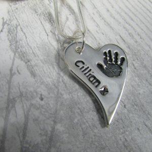 handprint charm slanted