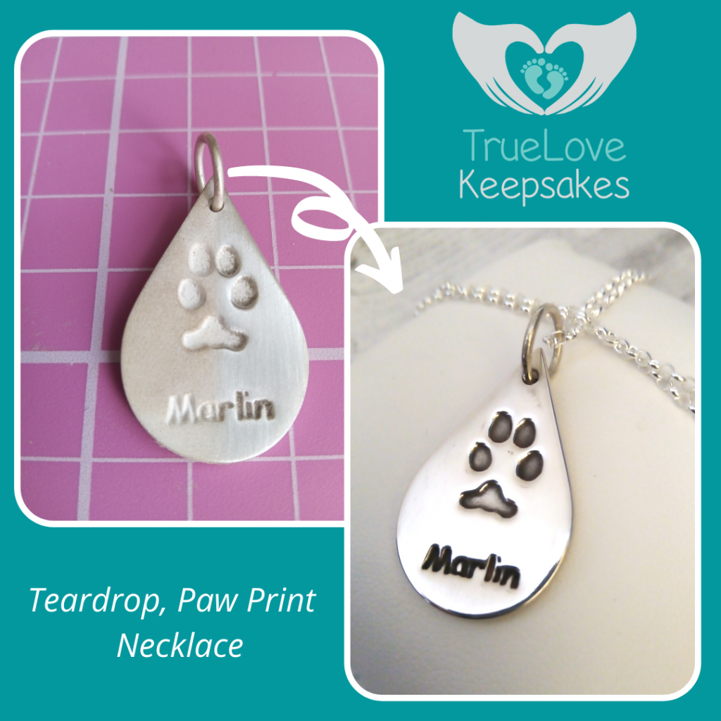 highly polished silver teardrop paw print charm featuring marly the Labrador's paw