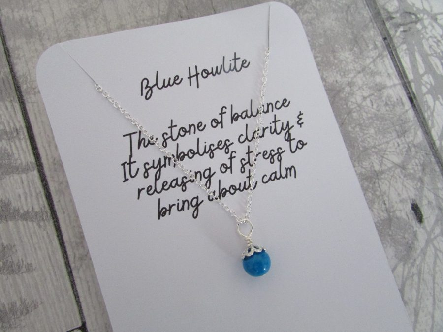 Blue Howlite semi precious gemstone necklace attached to a card holder explaining the properties of this gemstone