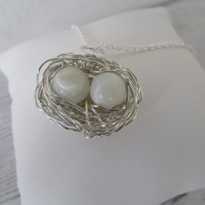 mother of pearl gemstone egg nest necklace with two gemstones for two children on an 18 inch trace chain