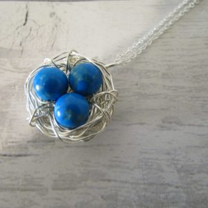 blue howlite gemstone egg nest necklace with three gemstones attached to an 18inch chain