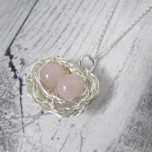 Rose Quartz Double Egg Nest Necklace round rose quartz gemstones in the centre of a wire-wrapped nest charm attached to an 18 inch chain