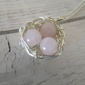 Rose Quartz Three Egg Nest Necklace entwined into the centre of a wire-wrapped bird's nest attached to an 18inch chain